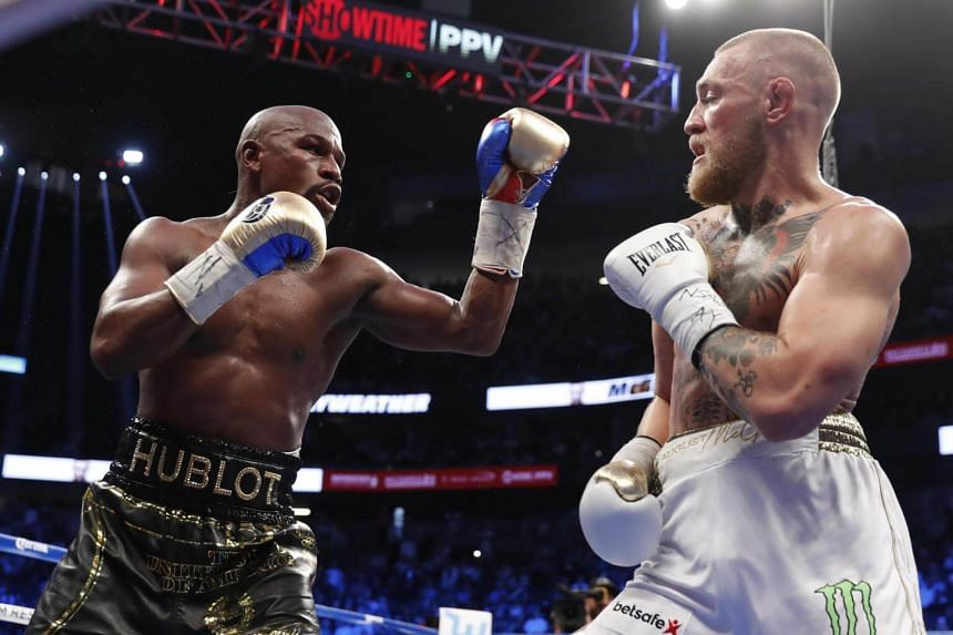 Floyd Mayweather Jr. in action with Conor McGregor.