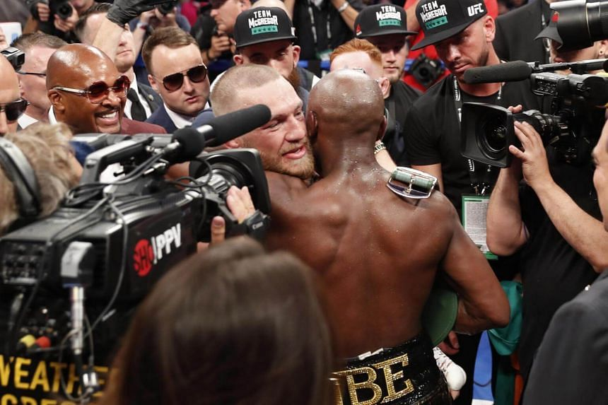 Floyd Mayweather Jr hugs Conor McGregor after winning the fight.