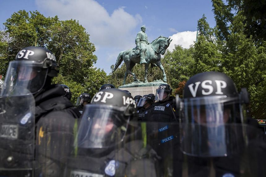Police at the white-nationalist rally in Charlottesville, Virginia, on Aug 12 did not initially wear riot gear, but as tensions rose that morning, officers donned the protective equipment.