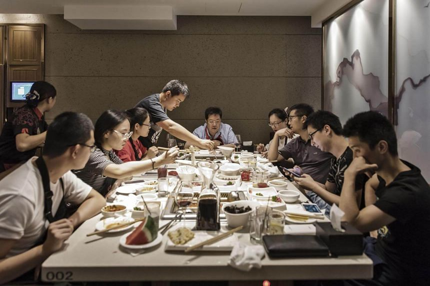 Customers dine at a Haidilao restaurant in Shanghai on July 9, 2017.