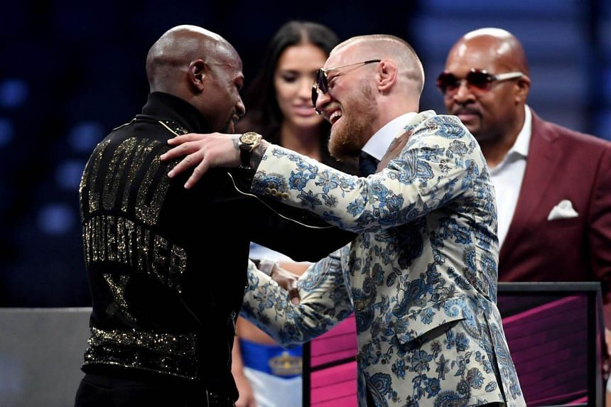 Floyd Mayweather Jr. (left) and Conor McGregor shake hands after Mayweather's 10th round TKO victory in their super welterweight boxing match on August 26, 2017 at T-Mobile Arena in Las Vegas, Nevada.