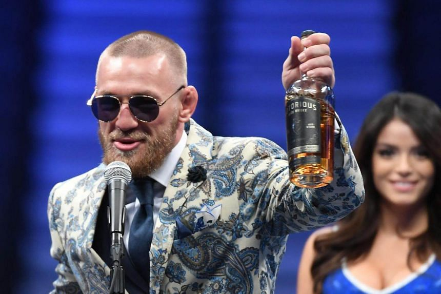 Conor McGregor speaks to the media while holding up his Notorious' brand of whiskey after losing to Floyd Mayweather Jr. by 10th round TKO in their super welterweight boxing match on August 26, 2017 at T-Mobile Arena in Las Vegas, Nevada.