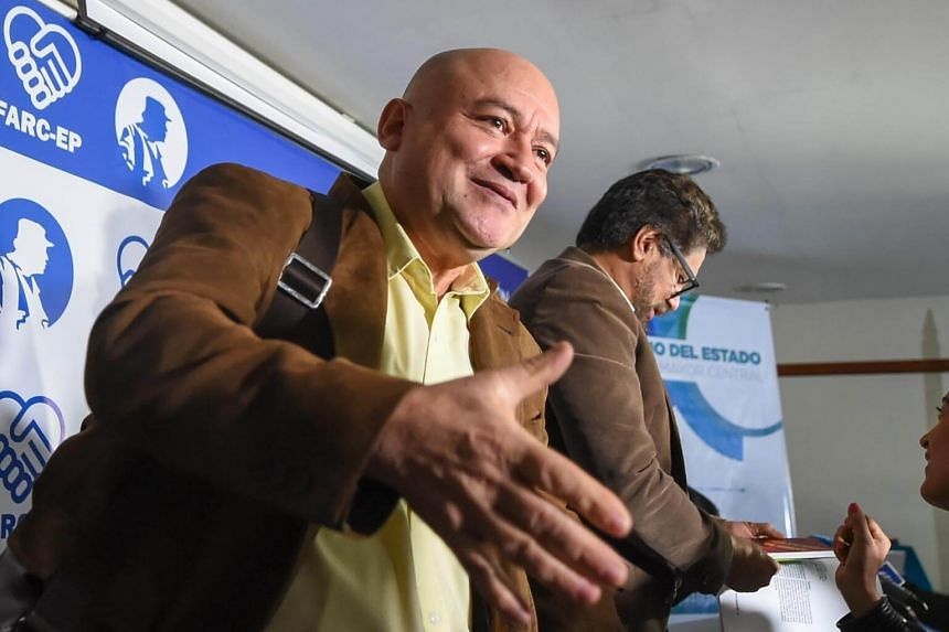 FARC commanders Carlos Lozada (left) and Ivan Marquez (right) speaking with journalists after a press conference announcing the launching of their political party in Bogota on July 24, 2017.