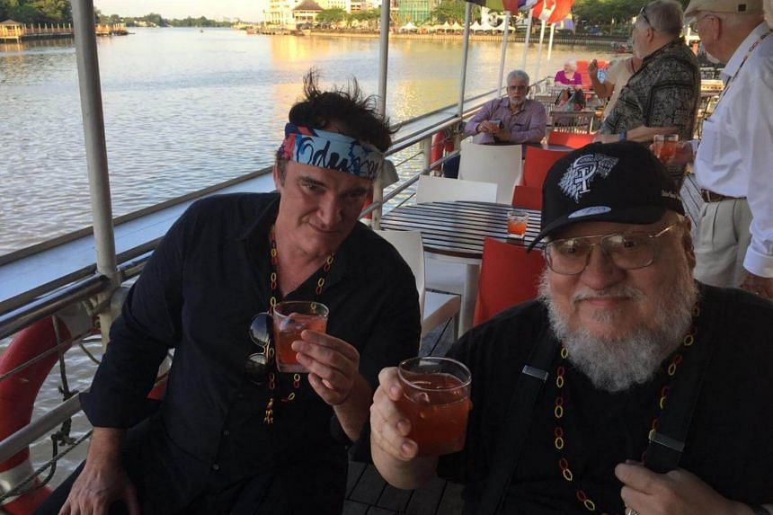 Game Of Thrones author George R. R. Martin (right) and filmmaker Quentin Tarantino enjoying drinks on board the Sarawak River Cruise in Kuching.
