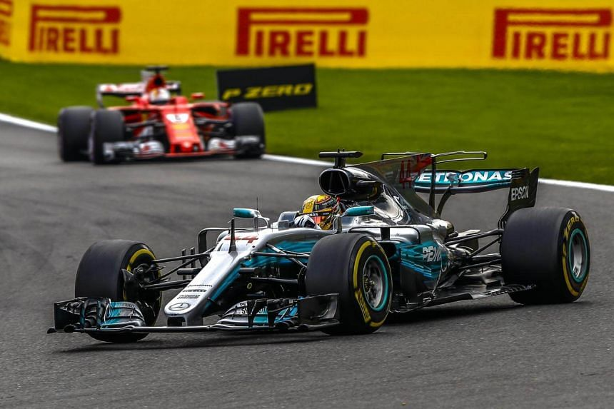 British Formula One driver Lewis Hamilton of Mercedes AMG GP leads followed by German Formula One driver Sebastian Vettel (back) of Scuderia Ferrari during the 2017 Formula One Grand Prix of Belgium at the Spa-Francorchamps race track near Francorcha