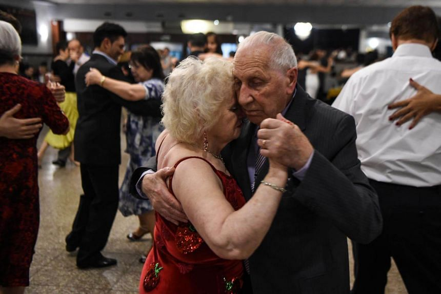 Tango dancers Nina Chudoba, 82, and Oscar Brusco, 90, dance at a Milonga (a place or an event to dance tango) in Buenos Aires, on Aug 18, 2017.