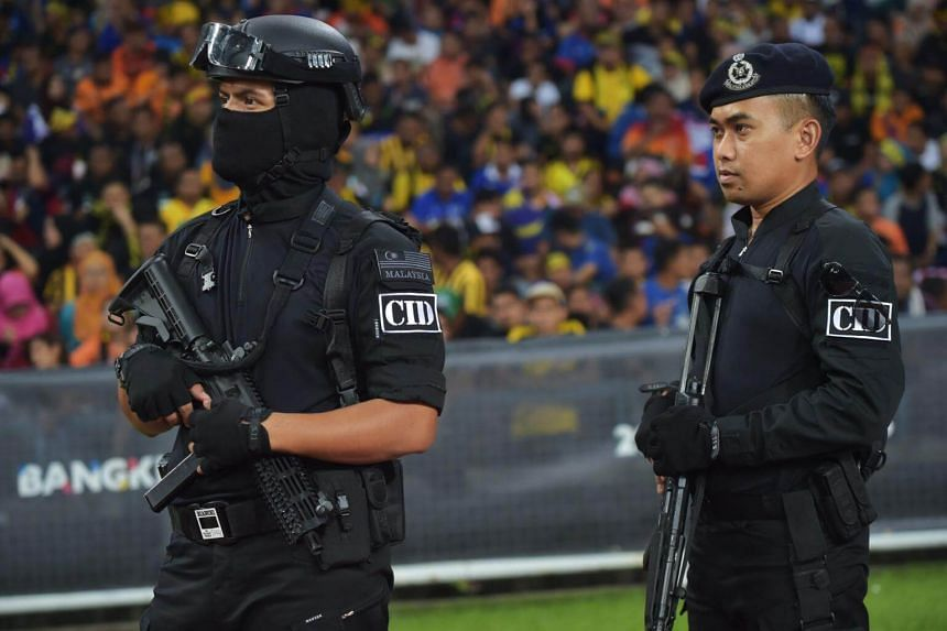 Malaysian Crime Investigation Department police stand guard during semi-final football match between Malaysia and Indonesia at the 29th Southeast Asian Games (SEA Games) in Kuala Lumpur on Aug 26, 2017.