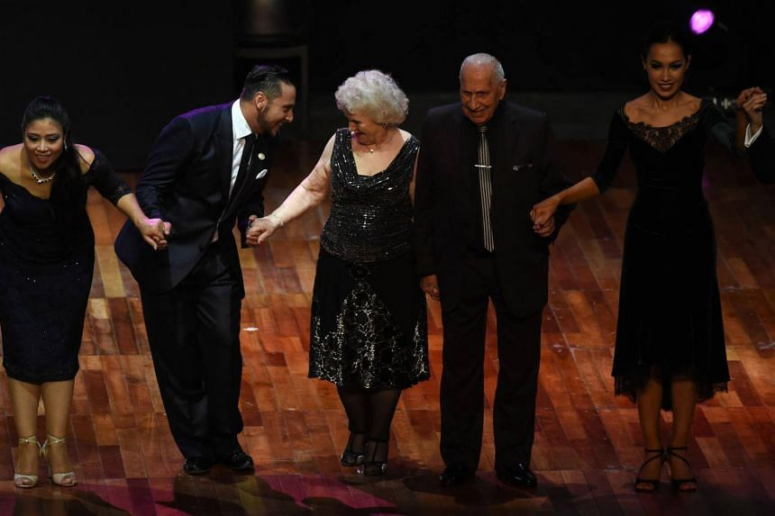 Tango dancers Nina Chudoba (centre), 82, and Oscar Brusco (second from right), 90, greet the audience after competing at the Tango Salon competition at the 15th Tango Dance World Championship in Buenos Aires, on Aug 22, 2017.