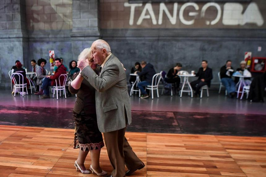 Tango dancers Nina Chudoba (right), 82, and Oscar Brusco , 90, dance at a Milonga (a place or an event to dance tango) in Buenos Aires, on Aug 18, 2017.