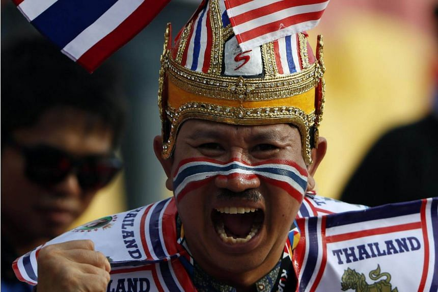 Supporter of Thailand cheers the team during the Group B match between Philippines and Thailand of SEA Games 2017 soccer events in Kuala Lumpur, Malaysia on Aug 22, 2017.