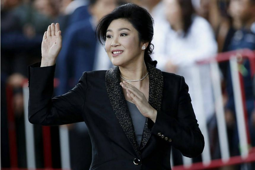 Former Thai prime minister Yingluck Shinawatra waves to supporters as she arrives to deliver closing statements in her trial at the Supreme Court's Criminal Division for Persons Holding Political Positions in Bangkok, Thailand, on Aug 1 2017.