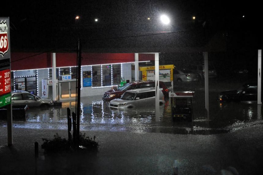 Cars sit abandoned at a flooded gas station after Hurricane Harvey made landfall on the Texas Gulf coast and brought heavy rain to the region, in Houston, Texas, on Aug 26, 2017.