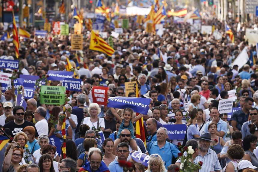 People attend a march against terrorism whose slogan is #NoTincPor (I'm Not Afraid) in Barcelona.
