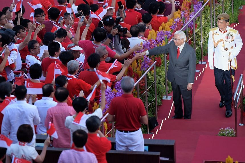 Dr Tony Tan, who will leave office on Thursday, greeting Singaporeans at the National Day Parade earlier this month. His presidency coincided with several eventful milestones, like Singapore's Golden Jubilee festivities.