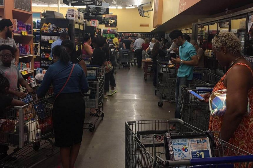 A queue at a supermarket in Houston, Texas, where shoppers were waiting for the truck containing water to arrive, hours before hurricane made landfall.