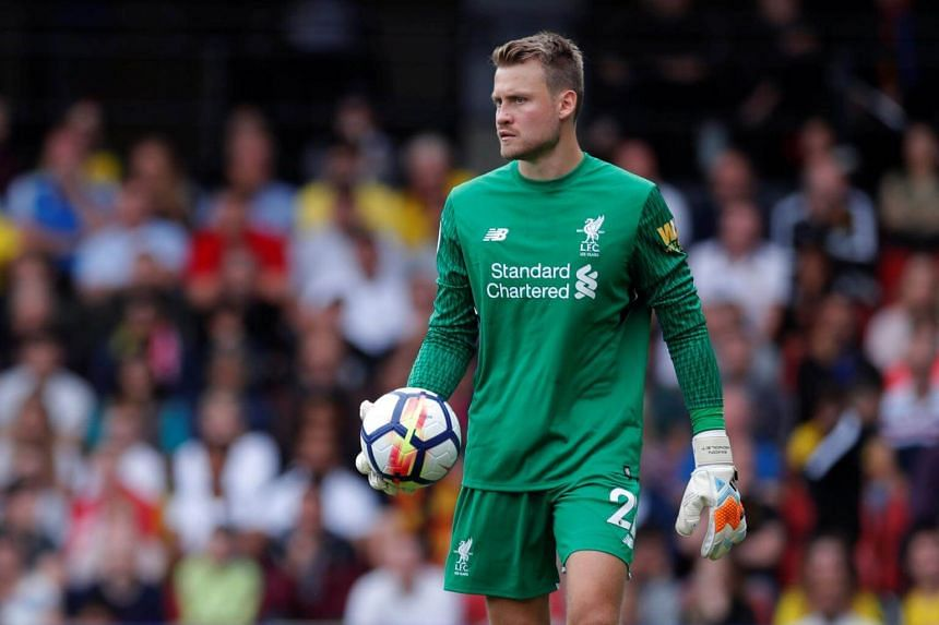 Liverpool's Simon Mignolet holds the ball during the Premier League match in Watford, Britain, on Aug 12, 2017.