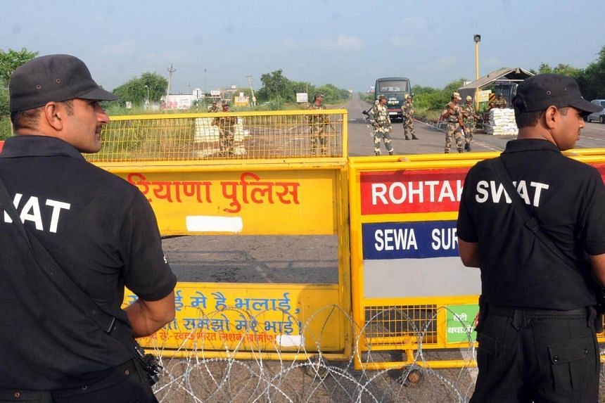 Indian security personnel stands guard on one of the roads leading to the Sunaria Jail where self-styled guru and spiritual leader Gurmeet Ram Rahim Singh is kept, in Rohtak, India, on Aug 28, 2017.
