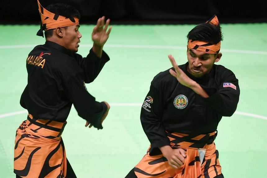 Mohamad Taqiyuddin bin Hamid and Rosli bin Mohamad Sharif of Malaysia perform during the Pencak Silat double final at the 29th Southeast Asian Games (SEA Games) in Kuala Lumpur on Aug 24, 2017.