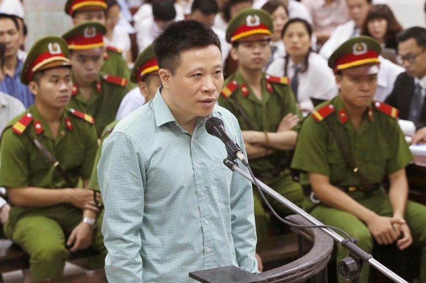Former Ocean Bank chairman Ha Van Tham, 44, stands trial at the People's Court in Hanoi, on Aug 28, 2017.