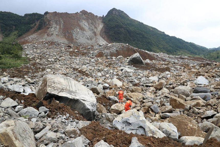 Rescue workers search for survivors at the site of a landslide that occurred in Nayong county, Guizhou province, China, on Aug 28, 2017.