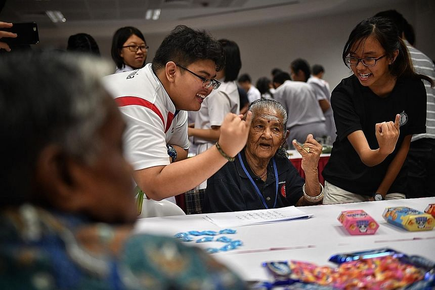 Students at yesterday's Service Learning Festival with an elderly person from the Lions Befrienders senior activity centre. More than 40,000 students have gone through the service learning programme since it was started in 2006 with the aim of giving
