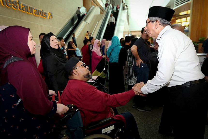 Minister-in-charge of Muslim Affairs Dr Yaacob Ibrahim seeing off some of the Singapore haj pilgrims on Thursday.