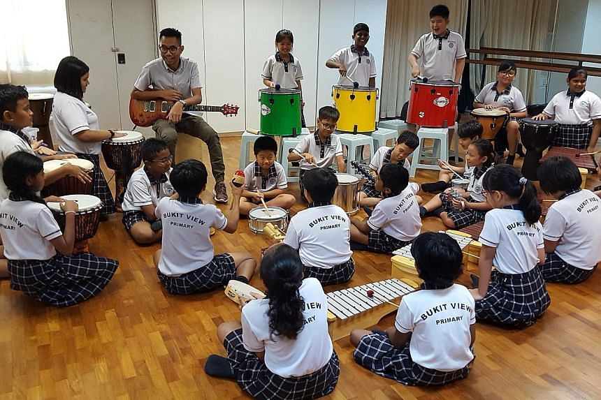 Mr Muhammad Dzuhri Juniwan exposes his pupils at Bukit View Primary School to a variety of musical instruments and incorporates different genres of music into his lessons.
