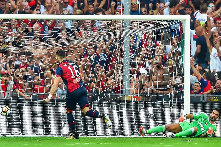 Forward Andrey Galabinov sends Gianluigi Buffon the wrong way with his seventh-minute penalty. He put Genoa 2-0 up against Juventus on Saturday but the Italian champions came back to win 4-2.