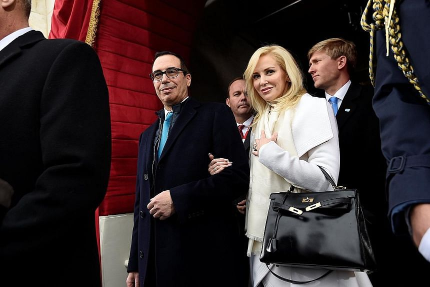 US Treasury Secretary Steven Mnuchin and actress Louise Linton - the couple were married on June 24 this year - at the presidential Inauguration of Mr Donald Trump in January. Amid the outrage sparked by his wife, Mr Mnuchin now faces the challenge o