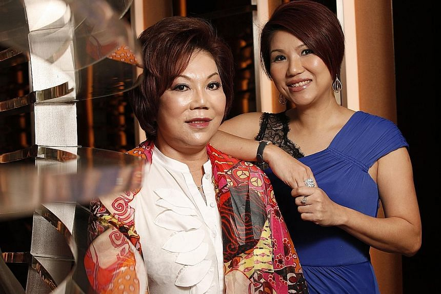 Madam Mary Chia, founder and former executive chairman of Mary Chia Holdings, with her daughter, Ms Wendy Ho Yow Ping, in a photo taken in 2012.