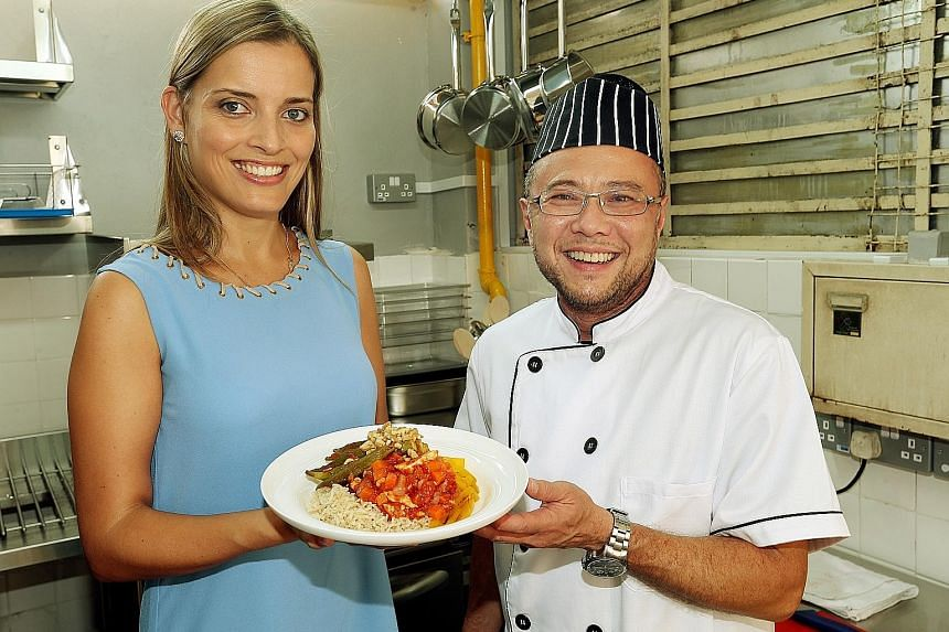 Px Plate's head dietitian, Ms Claudia Correia, and chef, Mr Thomas Chew, with one of the healthy meals prepared. The company's app will launch in the middle of next month.