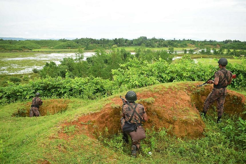 Bangladesh border guards at the border between Myanmar and Bangladesh. An estimated 2,000 Rohingya have made the crossing since last Friday, but at least 70 migrants have been sent back to Myanmar.