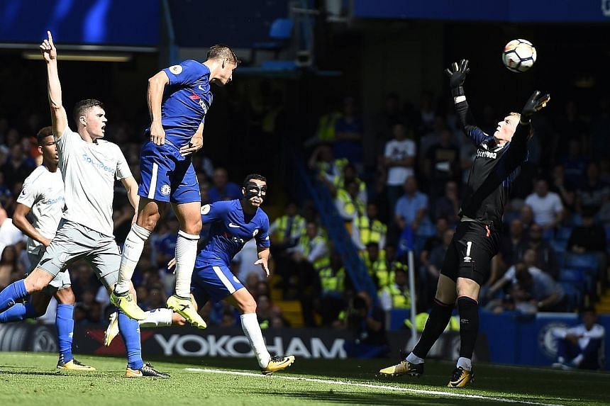 Alvaro Morata heads Chelsea into a 2-0 lead against Everton. The Spaniard also played a part in the hosts' opener, setting up Cesc Fabregas. The striker is the first player in Premier League history to score and create a goal in each of his first two