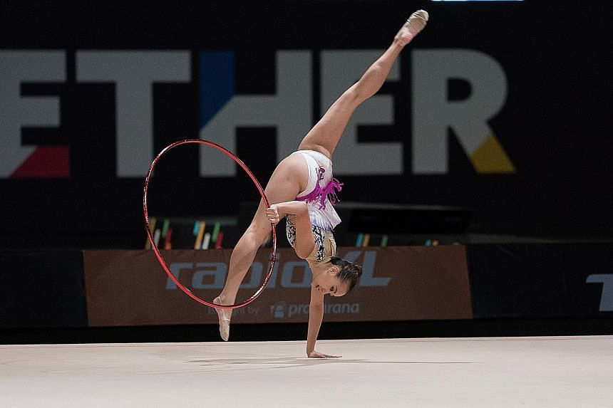 Rhythmic gymnast Tong Kah Mun in action during the all-round final at the KL SEA Games, in which she won the bronze.