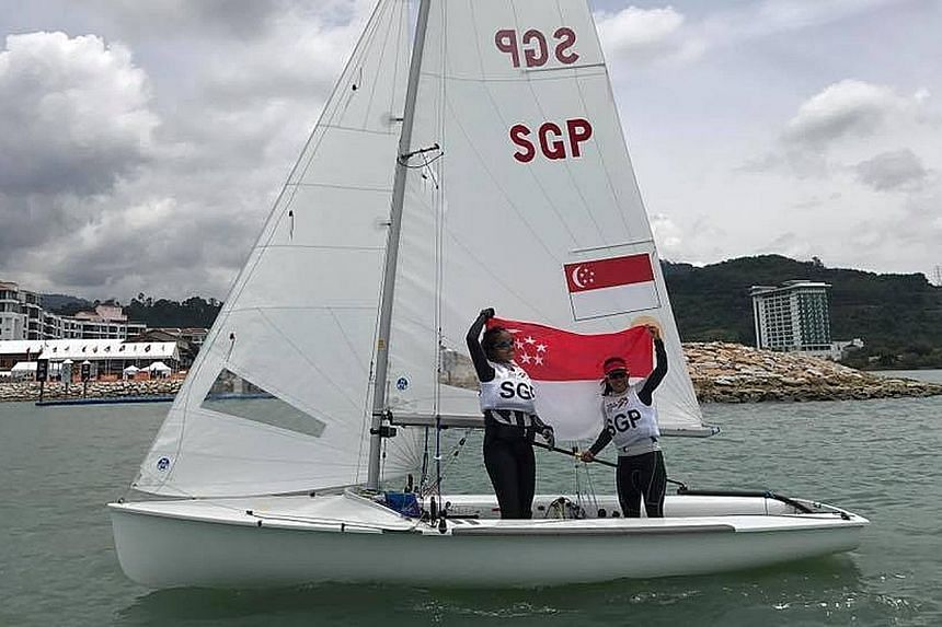 Sailors Cheryl Teo (left) and Yukie Yokoyama rejoice after winning the women's 470 title in Langkawi. Their win took hours to sink in, as they were underdogs against Malaysia.