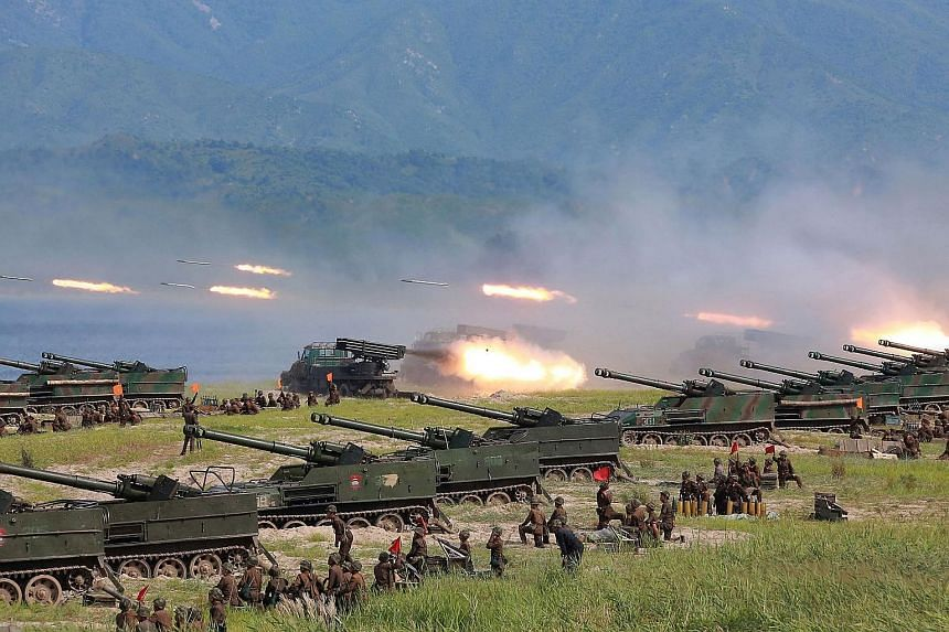 An undated photo released by North Korea's official news agency KCNA on Saturday shows rockets being launched during an exercise at an undisclosed location in North Korea. North Korea fired three short-range ballistic missiles on the same day, the US
