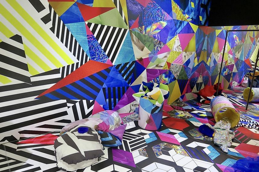 Visitors at the Singapore: Also on show was immersive work Xhe (above).