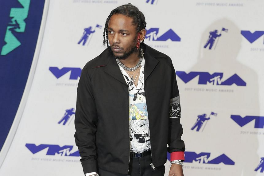 Rapper Kendrick Lamar arrives on the red carpet for the 34th MTV Video Music Awards (VMA) at The Forum in Inglewood, on Aug 27, 2017.