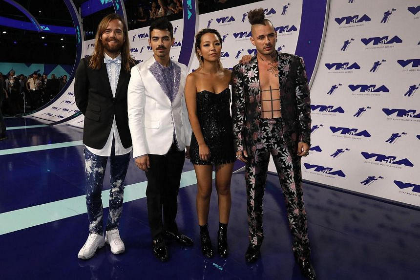 Members of the band DNCE arrive on the red carpet for the 34th MTV Video Music Awards (VMA) at The Forum in Inglewood, on Aug 27, 2017.