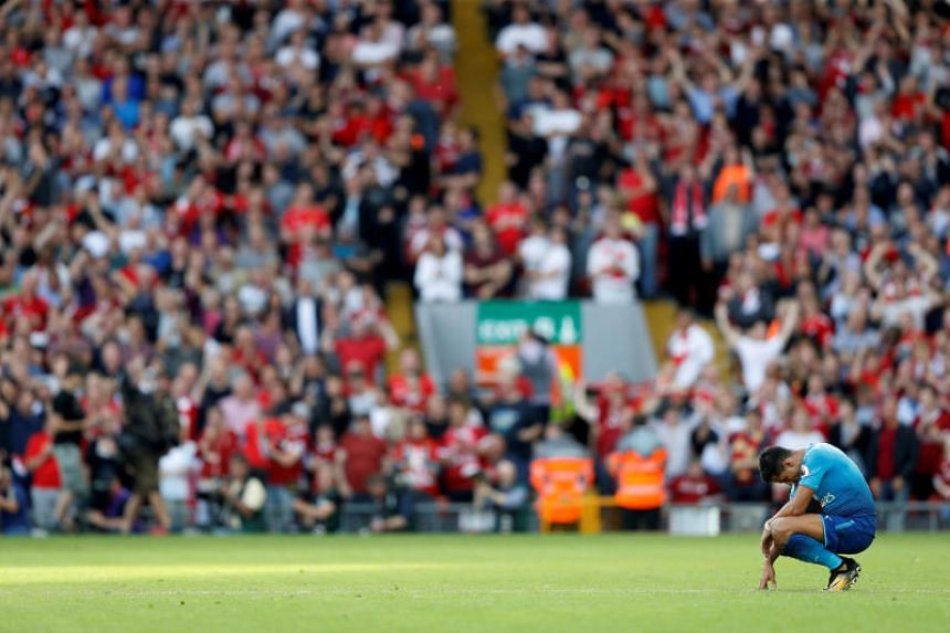Arsenal's Alexis Sanchez looks dejected after Liverpool's Mohamed Salah scores their third goal  on Aug 27, 2017.