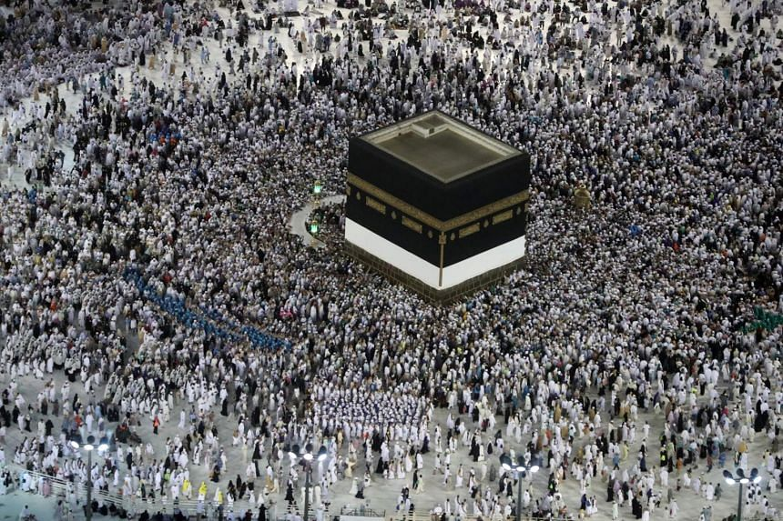 Muslim pilgrims prepare to circumambulate the Kaaba, Islam's holiest shrine, at the Grand Mosque in Saudi Arabia's holy city of Mecca prior to the start of the annual Hajj pilgrimage, on Aug 27, 2017.