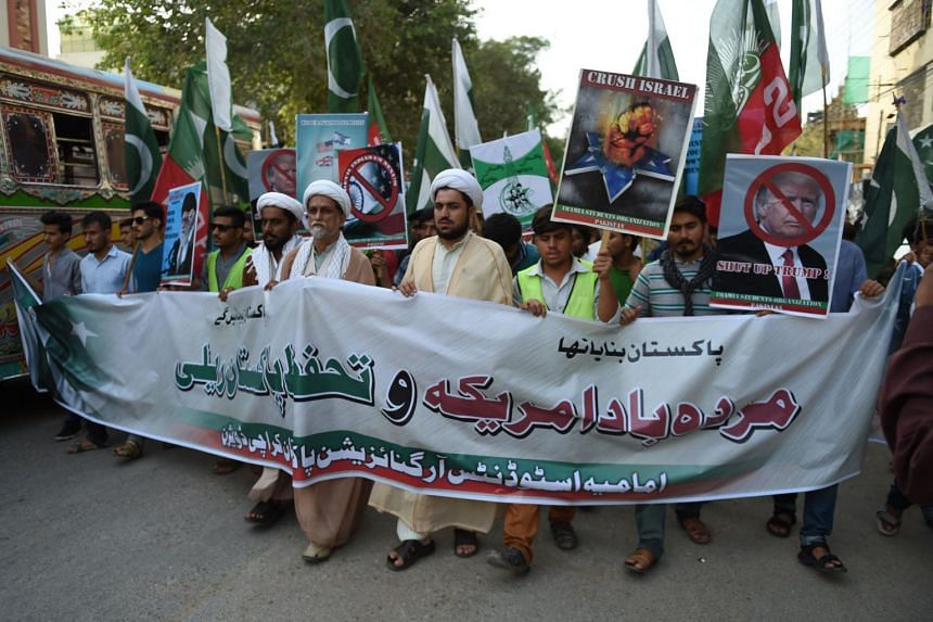 Protestors march towards the US consulate, in Karachi on Aug 27, 2017.