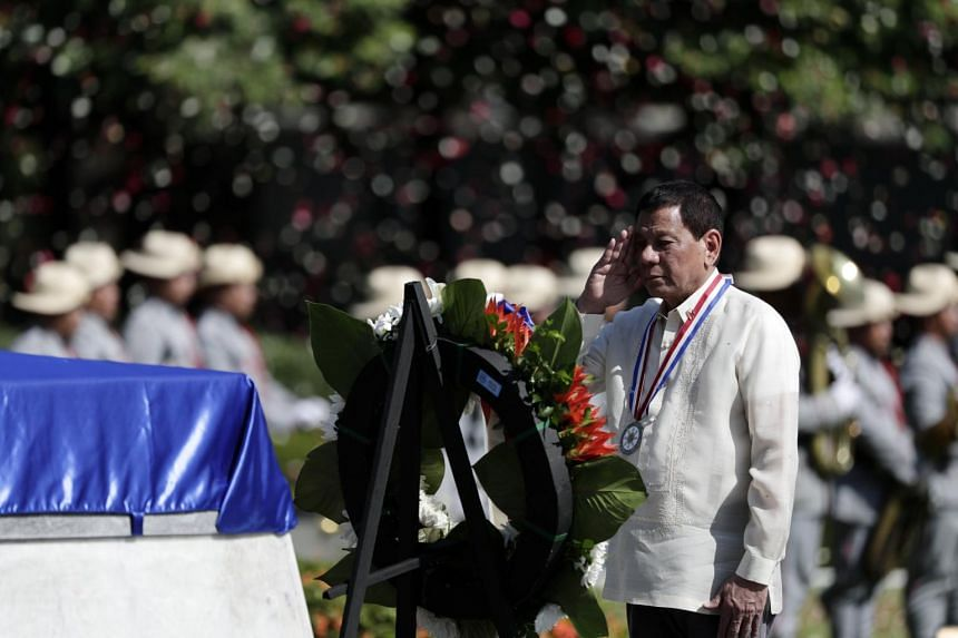 Philippine President Rodrigo Duterte salutes the tomb of an unknown soldier during a wreath-laying ceremony to mark National Heroes Day in Taguig City on Aug 28, 2017.