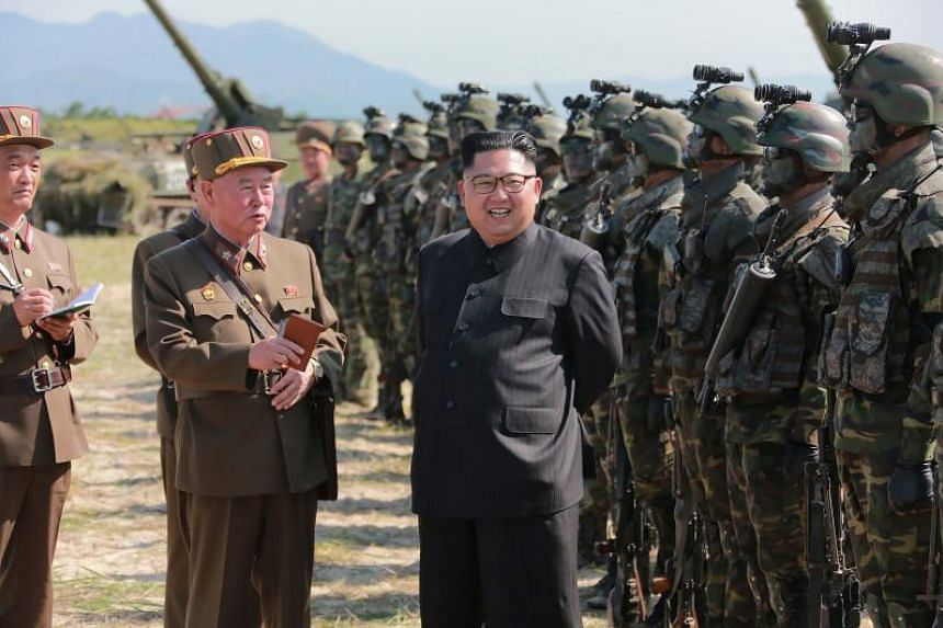 This undated photo released by North Korea's official Korean Central News Agency (KCNA) on Aug 26, 2017, shows North Korean leader Kim Jong Un presiding over a target strike exercise conducted by the special operation forces of the Korean People's Ar