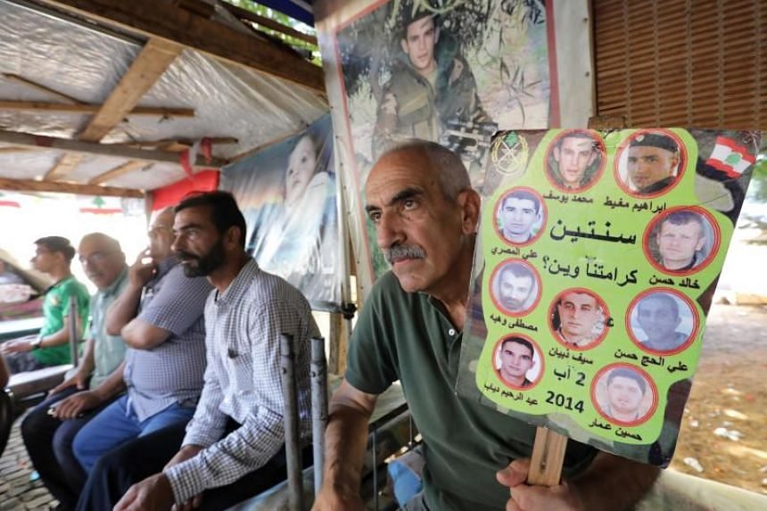 Relatives of Lebanese soldiers taken hostage by extremists in 2014 sit inside a tent as they gather in downtown Beirut on Aug 27, 2017 awaiting news of their loved ones.