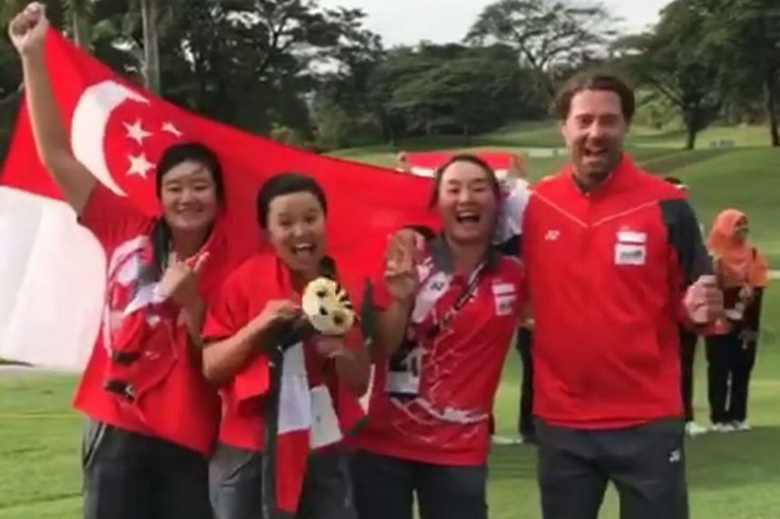 From left: Singapore golfers Sarah Tan, Jacqueline Young, Callista Chen and coach Andrew Welsford grinning like Cheshire cats. The players may not have won a medal but they enjoyed their Games debuts: http://bit.ly/2wJcBk4