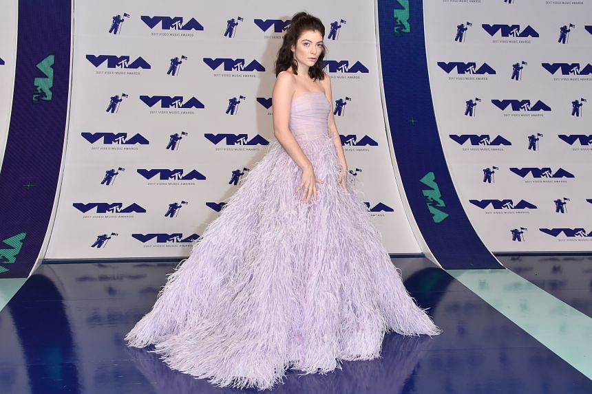Singer Lorde in a Monique Lhuillier gown at the VMA. PHOTO: AFP