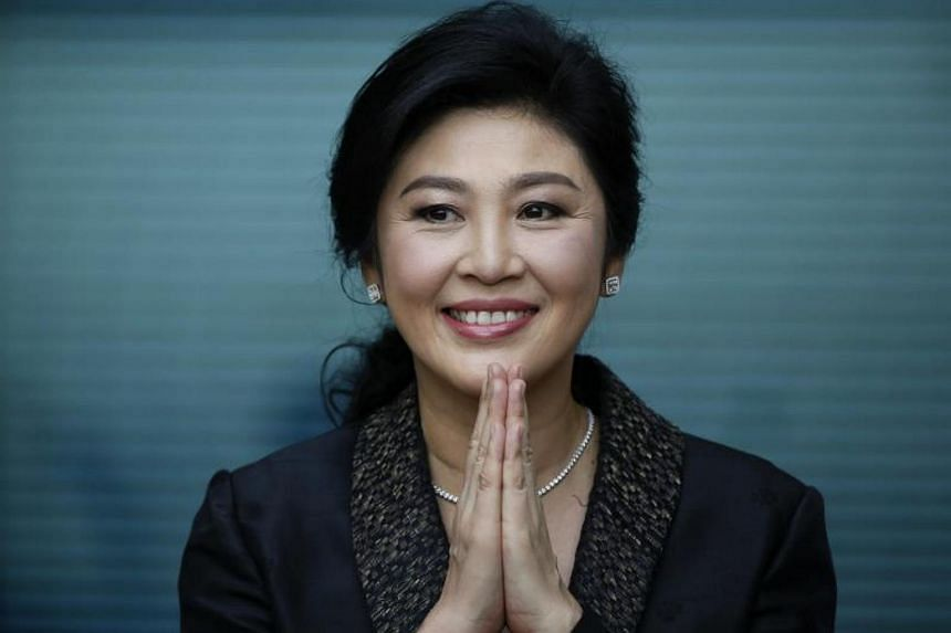 Former Thai prime minister Yingluck Shinawatra greets supporters as she arrives to deliver closing statements in her trial at the Supreme Court's Criminal Division for Persons Holding Political Positions in Bangkok, Aug 01, 2017