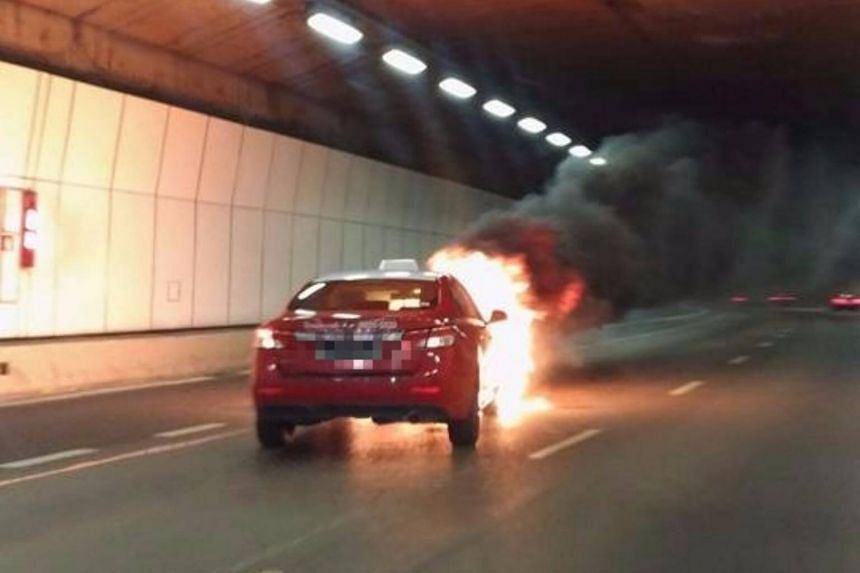 A Transcab taxi on fire in the Kallang-Paya Lebar Expressway (KPE) tunnel on Tuesday (Aug 29) night, causing smoke to fill the tunnel.