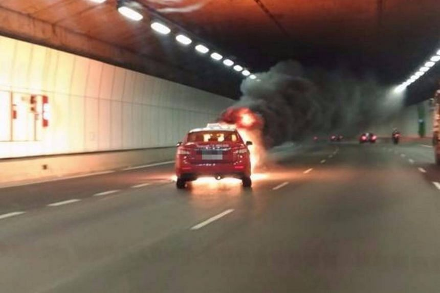 The Transcab ablaze in the KPE tunnel on Tuesday (Aug 29) night, causing smoke to fill the tunnel.